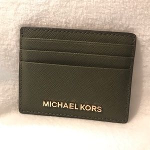 Michael Kors jet set travel credit card holder.